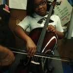 Discovery Day:  Thalia is introduced to the cello with Nioka Workman
